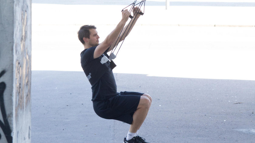 XUP Squats with reverse peck deck - buttocks training